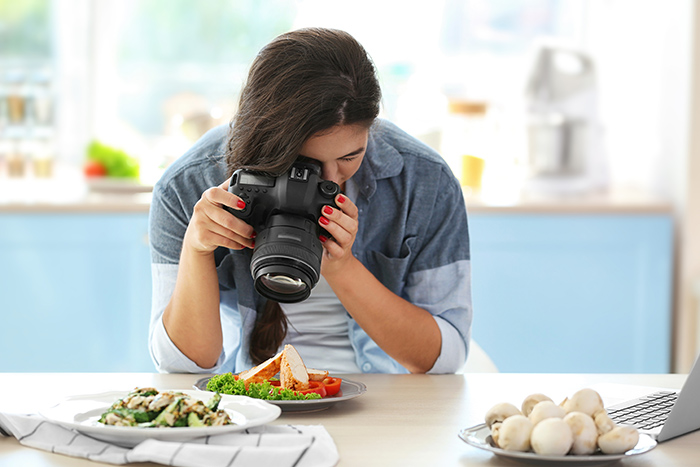 A Woman Making a Video of Food for Her Vlog